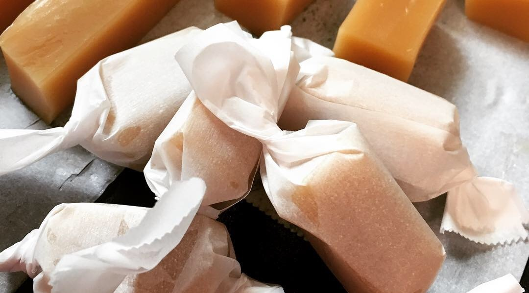 Salted Vanilla Caramel Candies wrapped in parchment paper