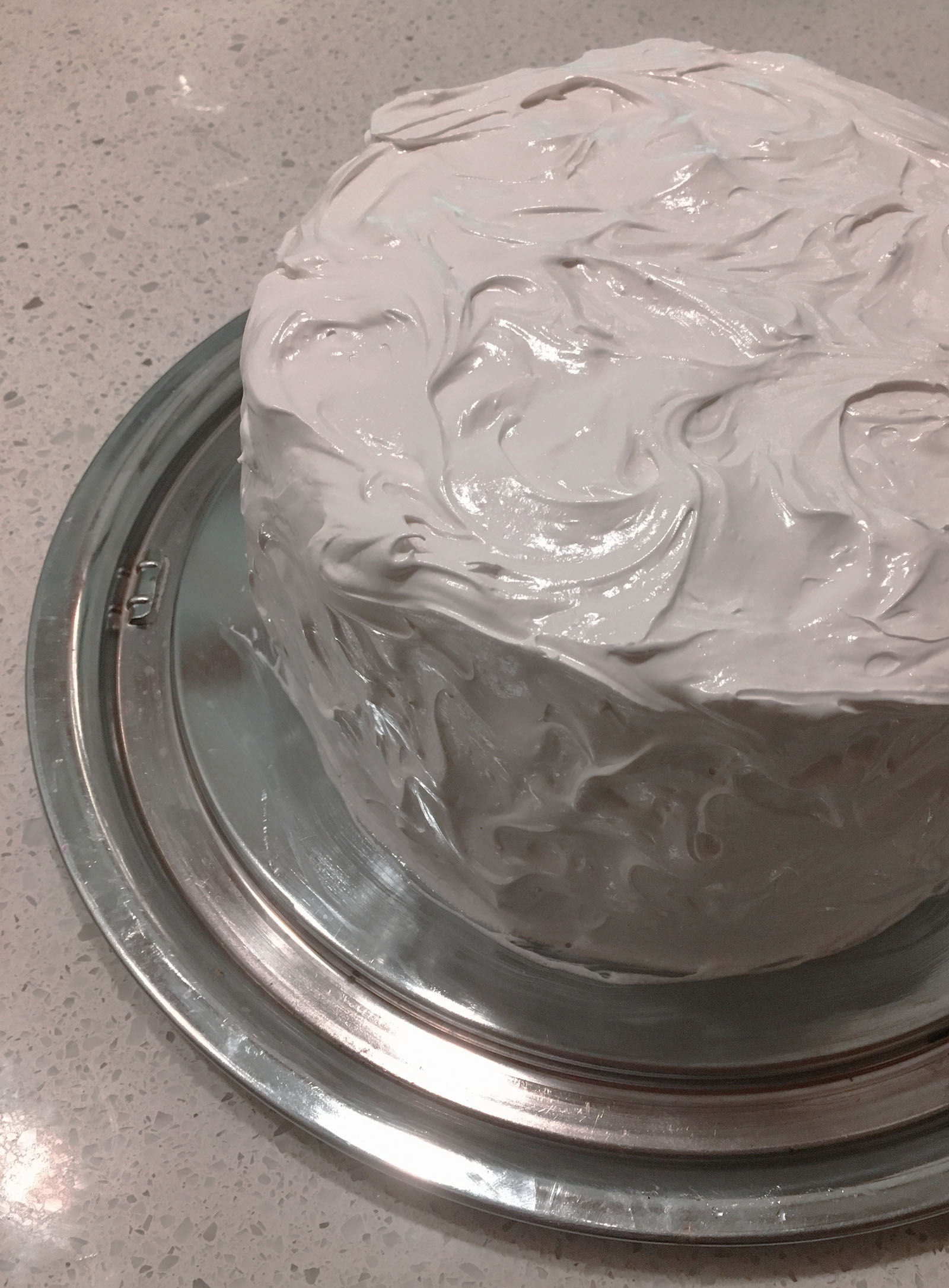 marshmallow fluff frosting on the outside of a cake
