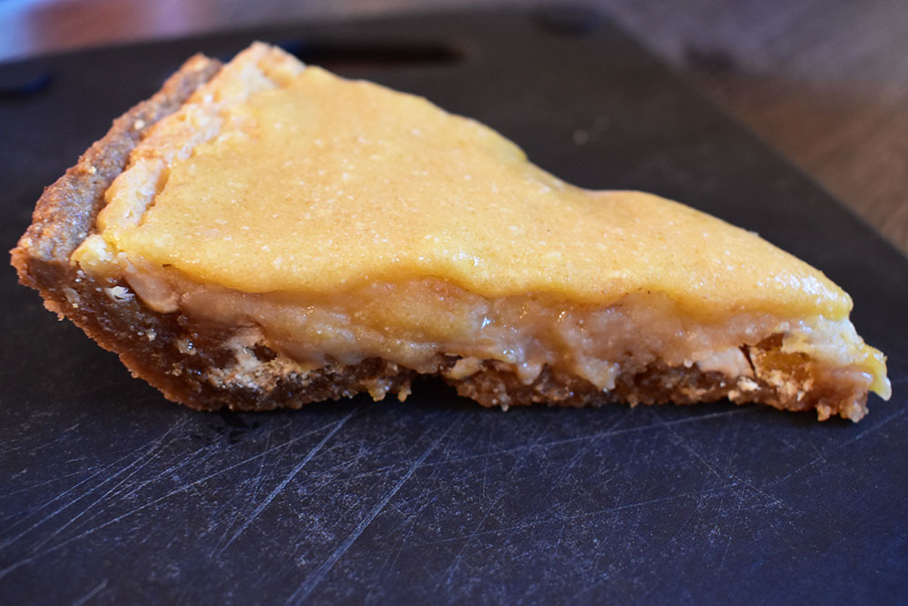 Hazelnut White Chocolate Blondie Pie in a slice